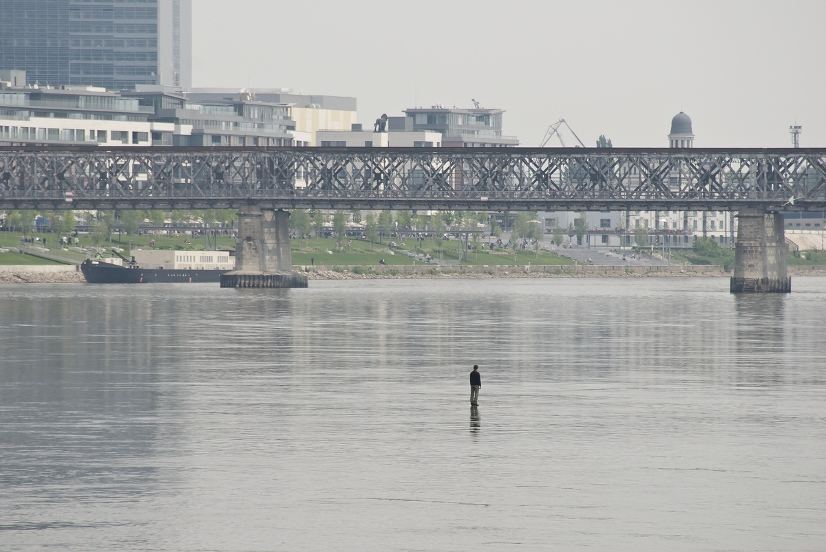 Tomáš Šoltys – Man on the River, 2011, site specific performance, photograph 2,7 x 4 m