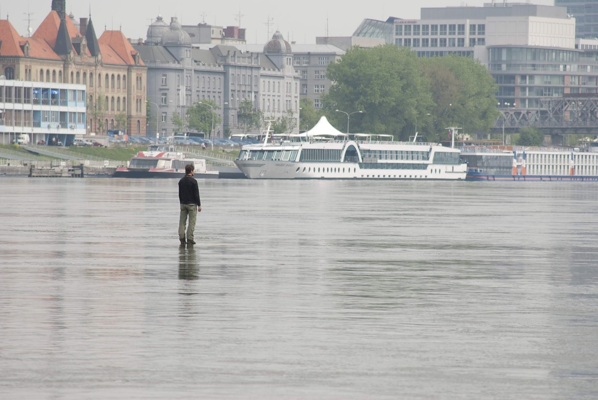 Tomáš Šoltys – Man on the River, 2011, site specific performance, photograph